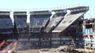 March 16 2010 WS Three excavators pulling down portion of the upper deck of the old Yankee Stadium / Bronx New York City
