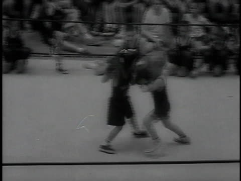 March 23, 1964 MONTAGE United States Naval Academy kid's boxing match / Annapolis, Maryland, United States