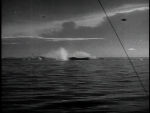 March 29 1945 MONTAGE Planes hit munitions ship with bomb causing tremendous explosion / Pacific Ocean