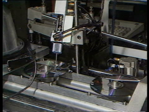 March 9, 1987 FILM MONTAGE CDs being manufactured in factory/ England