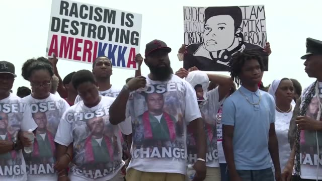 A march and memorial event was held on Sunday to mark the first anniversary of the death of Michael Brown the unarmed young black man killed by a...
