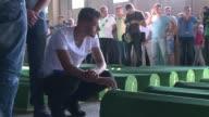 Marchers arrive at a Srebrenica memorial centre in Potocari on the eve of a commemoration of the massacre's 20th anniversary on Saturday