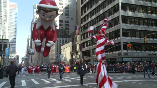 Marching band makes its way down 6th Avenue followed by the Domino Sugar float featuring country singer Trace Adkins / The ELF ON A SHELF balloon...