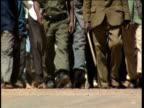 Marching legs of demonstrators undertaking protest Democratic Republic of Congo