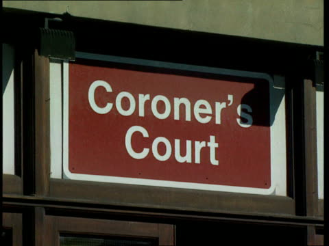 Inquest to be reopened Relatives of victims waiting in street Ditto Sign on wall 'Coroner's Court' Front entrance to coroner's court TILT UP Reporter...