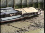 'Marchioness' report ITN LIB SEQ Marchioness wreckage on riverbank CMS Bowbelle dredger moored PULL OUT
