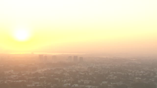 HA XWS City in fog smog w/ pastel pink yellow blue BG REVERSE PAN City XWS Bright yellow sky white hot sunpink extending onto city PAN to original...
