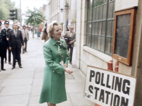Margaret Thatcher arrives at a polling station to vote in the EEC referendum and is greeted by Nicholas Scott MP