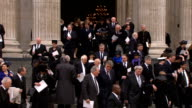 funeral service INT Candles being snuffed out/ high angle shot of congregation leaving/ Katherine Jenkins departure/ INT Hugh Scully / Alex Salmond...