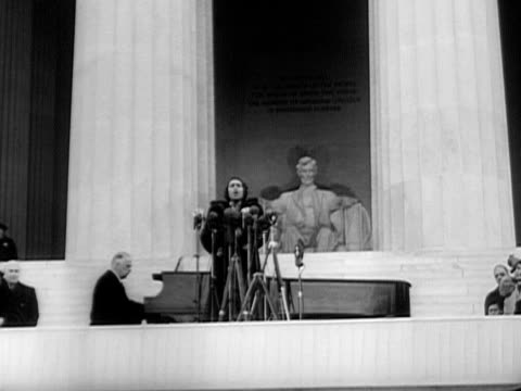 Marian Anderson singing on steps of Lincoln Memorial during openair concert on Easter Sunday April 9 1939 / WS PAN Crowd listening to concert with...