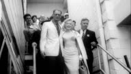 Marilyn Monroe and playwright Arthur Miller walking down steps at Idlewild Airport on their way to London July 13 1956 in Queens New York
