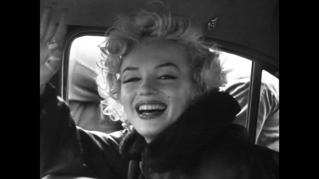Marilyn Monroe smiling from car while visiting Gis in Korea