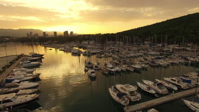AERIAL Marina and city on the coast