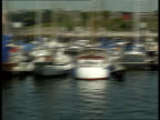 Business monopoly threatens yachting Plymouth Marina GVs 'Queen Anne's Battery Marina' banner on bridge Tracking shot through harbour GVs Mayflower...