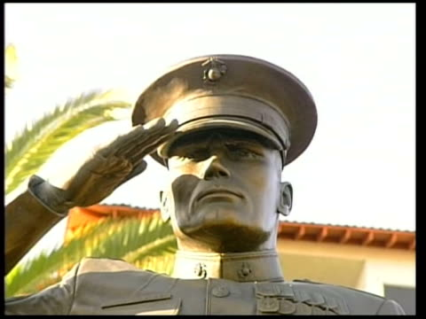 US marine battalion accused of Haditha massacre detained Close shot and side view of statue of saluting marine outside Camp Pendleton Marine Base