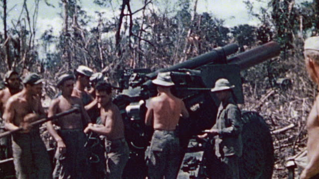 S Marine Corps artillerymen loading tracking and firing artillery on chassis / Peleliu Palau