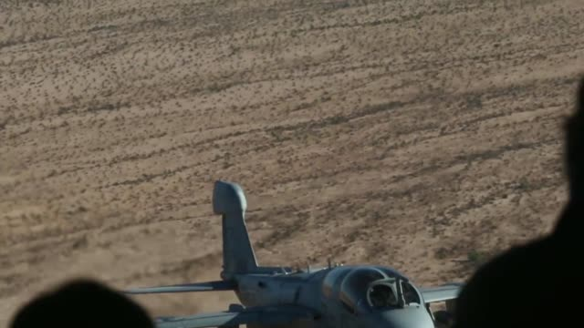 A US Marine Corps EA6B Prowler assigned to Marine Aviation Weapons and Tactics Squadron One conducts an aerial refuel in support of Weapons and...