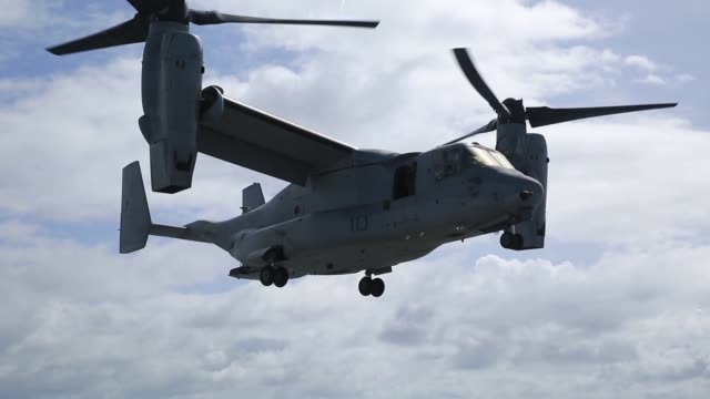 US Marine Corps MV22B Ospreys and CH53E Super Stallions assigned to Marine Aircraft Group 16 3rd Marine Aircraft Wing embark aboard the USS Essex in...