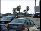 US marine directing traffic at entrance to Camp Pendleton marine base
