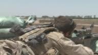 A U.S. Marine fires his 50 caliber M107 sniper rifle at a Taliban target.