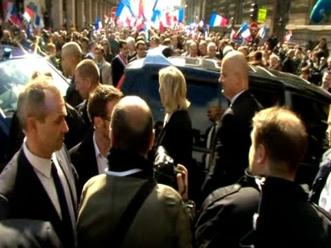 Marine Le Pen leader of the french rightwing political party Front National waves at cheering supporters