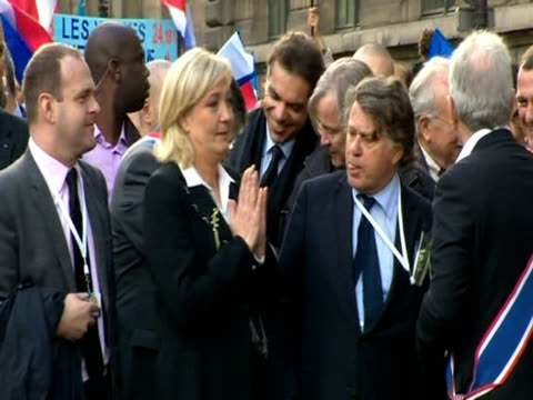 Marine Le Pen leader of the french rightwing political party Front National stands amongst supporters