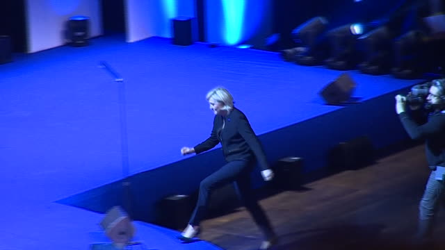 Marine Le Pen walking up to the stage to give a speech on her Presidential campaign trail