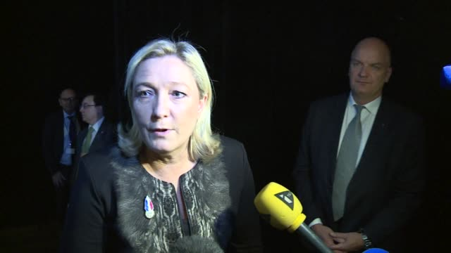 Marine Le Pen won 100 percent backing to stay on as the unchallenged chief of France's far right National Front party in party congress vote results...