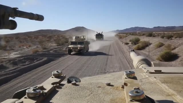 Marine with Alpha Company 1st Tank Battalion conduct attacks on mock enemy position during Exercise Desert Scimitar 2014 The training gave the Marine...