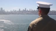 Marines and Sailors assigned to USS America man the rails as the ship pulls into port for Fleet Week San Francisco Oct 6 2014 During Fleet Week...