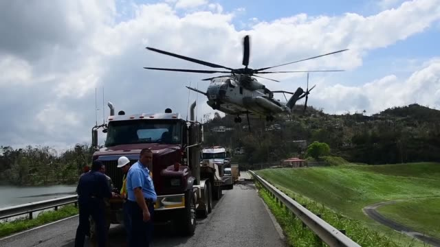 A US Marines Corps CH53 Sikorsky Sea Stallion heavylift transport helicopter lifts fiveton Jersey barriers into the Guajataca Dam in Guajataca...