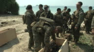 US Marines pack gear on the beach head during the USThai joint military exercise titled 'Cobra Gold' on Hat Yao beach in Chonburi province eastern...