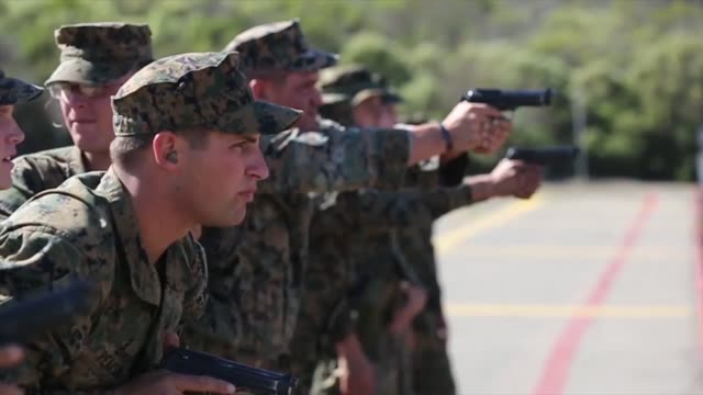 Marines with 1st Marine Division qualify with the pistol through the new Combat Pistol Program during a combat marksmanship coach course here Nov 7...