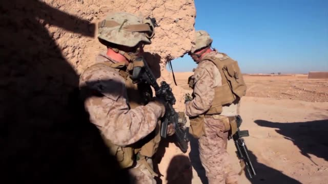 Marines with Bravo Company 1st Battalion 9th Marines launched an interdiction operation near the Bari Gul Bazaar in Nad Ali Disctrict Helmand...