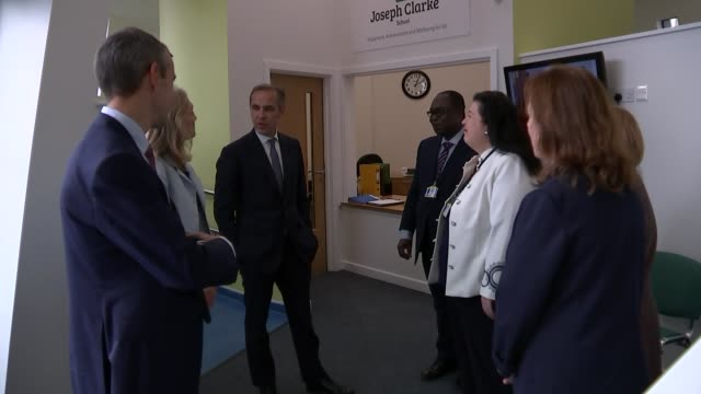 Mark Carney visits school / interview EXT Joseph Clarke School general views / Mark Carney arriving and greeting people Mark Carney walks into school...