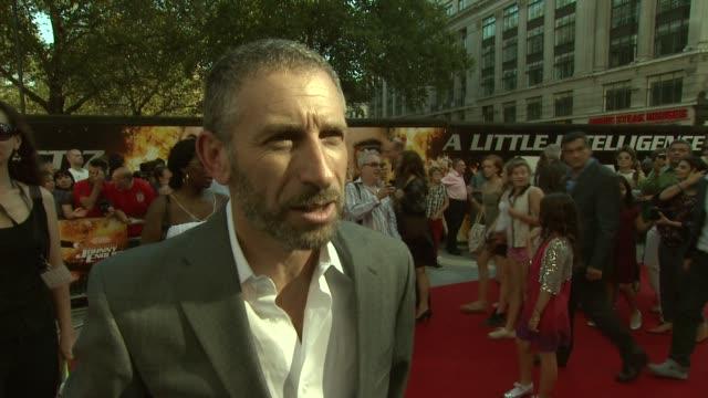 Mark Ivanir on his memories of Rowan Atkinson at the Johnny English Reborn UK Premiere at London England
