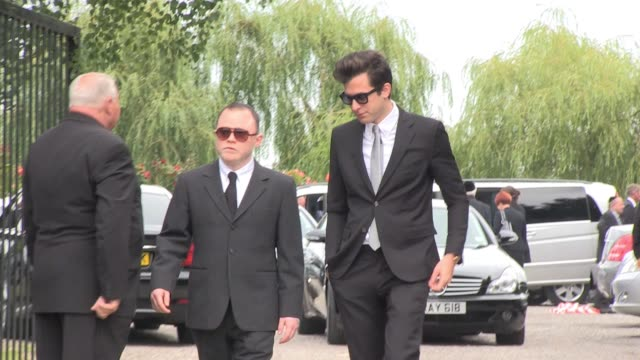 Mark Ronson leaves on foot from Edgwarebury Cemetery after so many friends and relatives attended Amy Winehouse's funeral that the car parks exceeded...