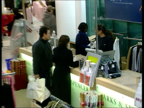 Marks Spencer to cut 450 jobs LIB Customers at counter PULL OUT store Women looking at clothes