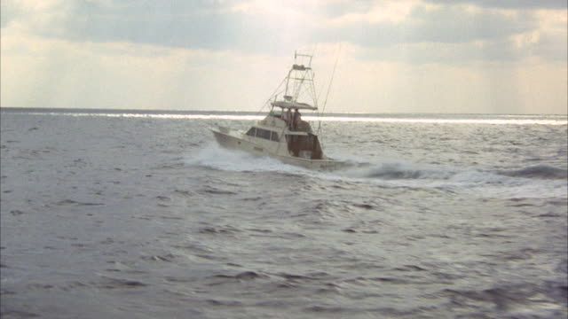 AERIAL TS Marlin type fishing boat moving on ocean