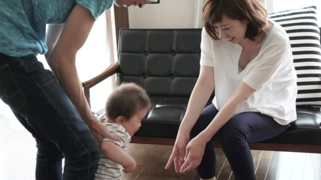 Married couple and Baby Boy having fun time in house.