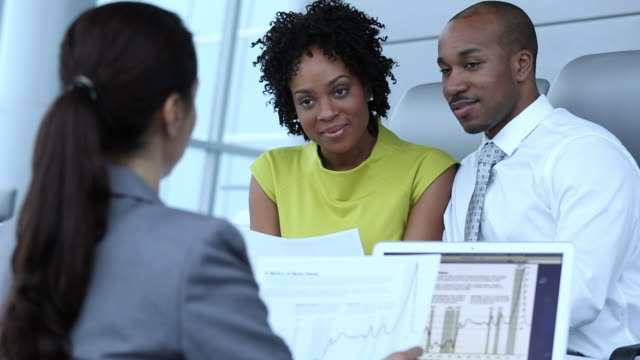 MS Married Couple Meeting with Financial Advisor in Bank Office, Shaking Hands / Richmond, Virginia, United States