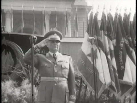Marshal Tito watches a parade of Soviet soldiers tanks and airplanes in Moscow