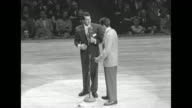 Martin and Lewis on stage hold hands as Lewis jumps around / WS audience / at microphone they do schtick Martin asks if he wants to sing in unison...