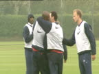 Martin Keown and Patrick Viera larking around Dennis Bergkamp jokingly tells them off while keeping his face deadpan straight during Arsenal FC...