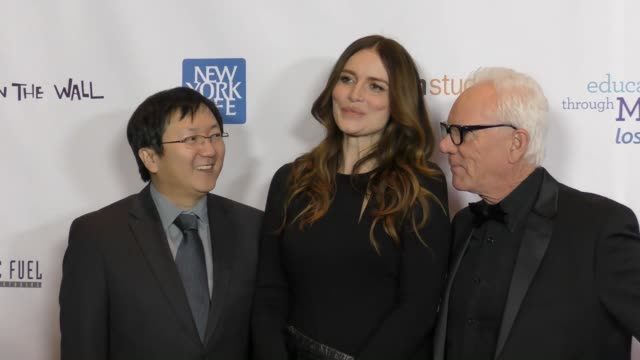 Masi Oka Saffron Burrows Malcolm McDowell at the Education Through MusicLos Angeles Gala on November 28 2017 in Los Angeles California