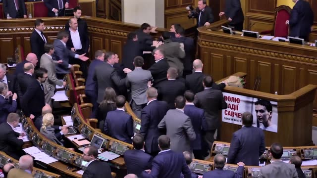 A mass brawl erupts in the Ukrainian parliament when Prime Minister Arseniy Yatsenyuk is attacked by a political opponent as he addresses the chamber