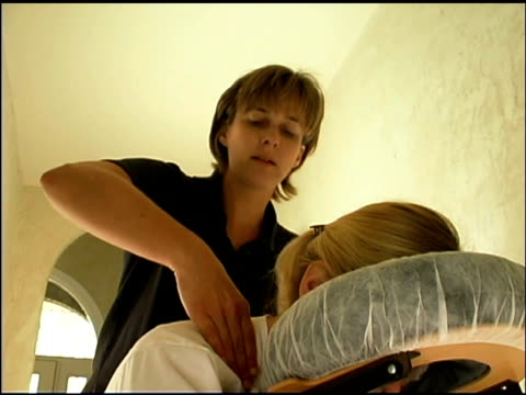 Massage therapist with patient