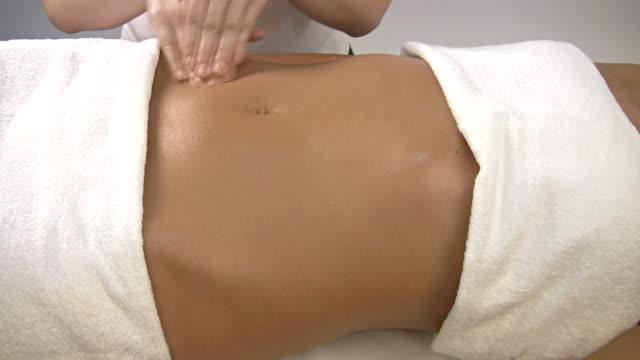 Massaging stomach