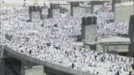 Massive crowds surge across an elevated structure in Mecca, Saudi Arabia.