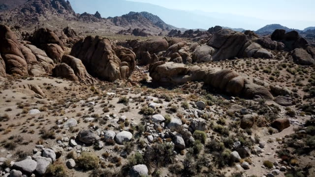 Massive Rock Formations and Undergrowth in Desert